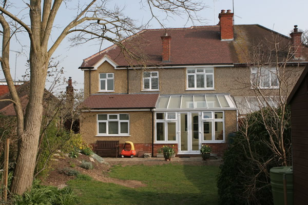 This is the rear of the property showing the finished extension with the new conservatory.