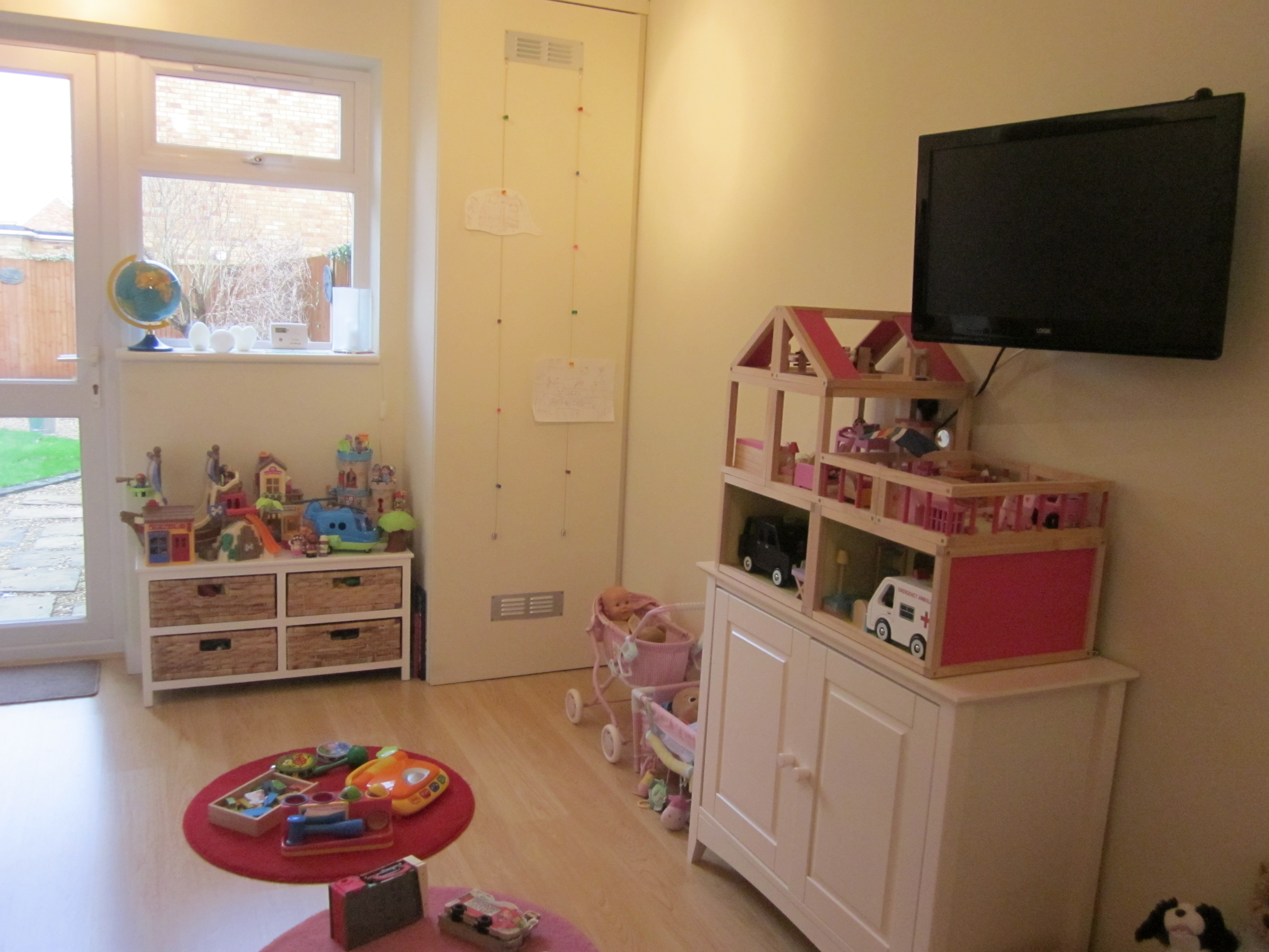 The new play area with door leading to garage.