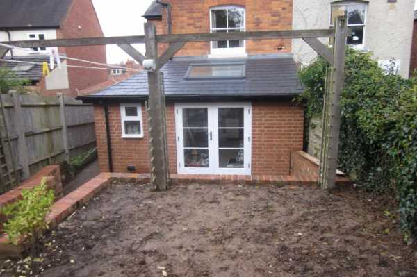 Rear view of completed extension and patio